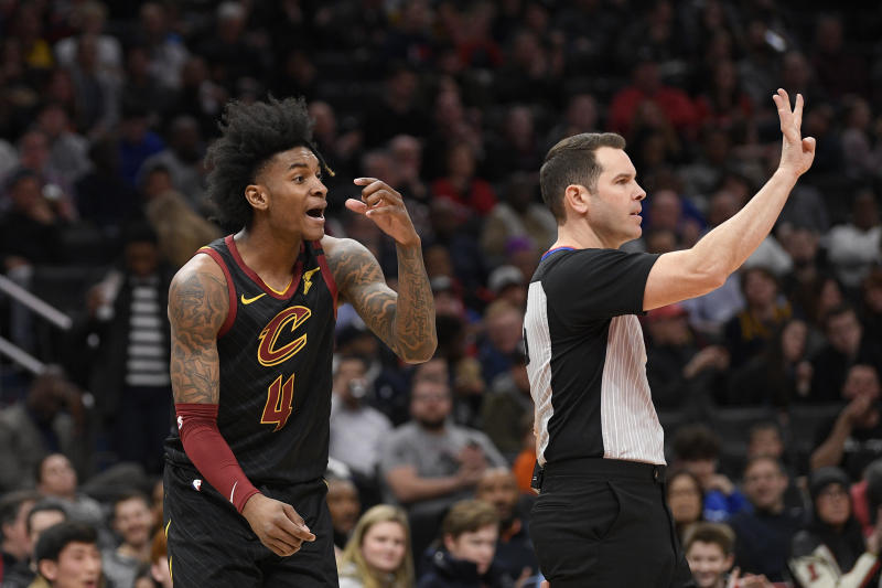 Cleveland Cavaliers guard Kevin Porter Jr. (4) reacts after he was called for a foul during the first half of the team's NBA basketball game against the Washington Wizards, Friday, Feb. 21, 2020, in Washington. (AP Photo/Nick Wass)