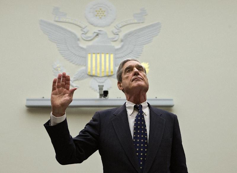 FBI Director Robert Mueller is sworn in on on Capitol Hill in Washington, Thursday, June 13, 2013, prior to testifying before the House Judiciary Committee as it holds an oversight hearing on the FBI. Mueller is nearing the end of his 12 years as head of the law enforcement agency that is conducting high-profile investigations of the Boston Marathon bombings, the attacks in Benghazi, Libya, and leaks of classified government information. The committee's chairman, Rep. Bob Goodlatte, R-Va., said when it comes to national security leaks, it's important to balance the need to protect secrecy with the need to let the news media do their job. (AP Photo/J. Scott Applewhite)