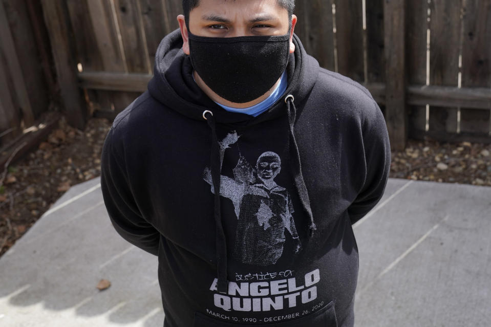Andrei Quinto wears a shirt with an image of his brother, Angelo Quinto, while posing for photos during an interview in Antioch, Calif., Tuesday, March 16, 2021. Angelo Quinto died three days after being restrained on Dec. 23, 2020, in police custody while having a mental health crisis. Lawmakers in several states are proposing legislation that would require more training for police in how to interact with someone in a mental crisis following some high-profile deaths. (AP Photo/Jeff Chiu)