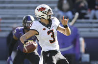 Oklahoma State quarterback Spencer Sanders (3) throws downfield against TCU during the first half of an NCAA college football game Saturday, Dec. 5, 2020, in Fort Worth, Texas. (AP Photo/Ron Jenkins)