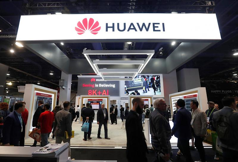 FILE PHOTO: Attendees pass by a Huawei booth during the 2019 CES in Las Vegas, Nevada, U.S. January 9, 2019. REUTERS/Steve Marcus