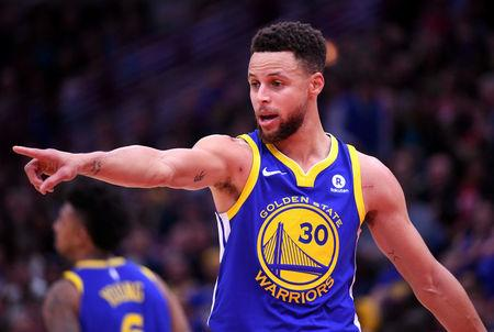 FILE PHOTO: Golden State Warriors guard Stephen Curry reacts in Chicago