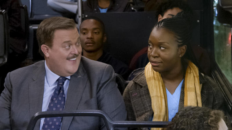 "This image released by CBS shows Billy Gardell as Bob, left, and Folake Olowofoyeku as Abishola in a scene from ""Bob (Hearts) Abishola,"" a comedy about a nurse and the former cardiac patient who pursues her.  (CBS via AP)"