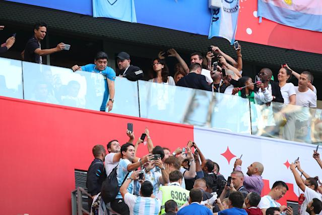 <p>Argentina legend Diego Maradona throws a flag to fans prior to the 2018 FIFA World Cup Russia group D match between Nigeria and Argentina at Saint Petersburg Stadium on June 26, 2018 in Saint Petersburg, Russia. (Photo by Robbie Jay Barratt – AMA/Getty Images) </p>