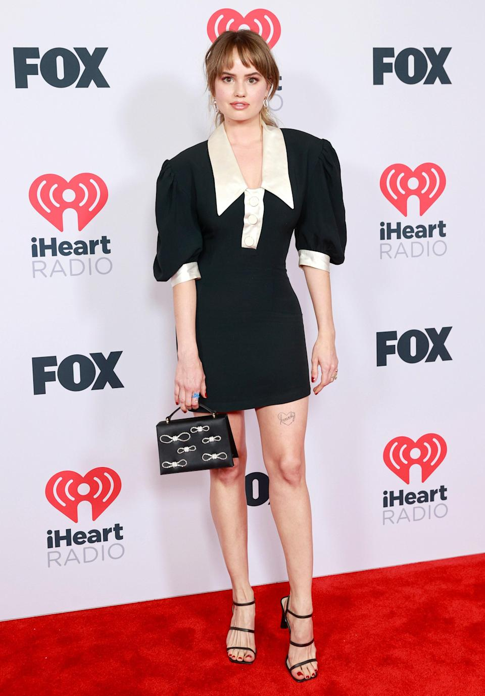Debby Ryan was also present and rocked a fitted mini dress with oversized sleeves. Her bow mini bag was a sweet touch.