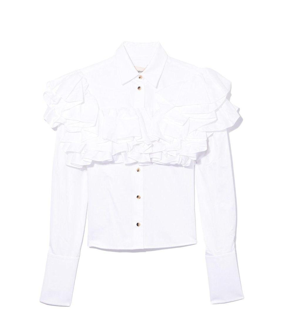 """<p><strong>Khaite</strong></p><p>ShopBAZAAR.com</p><p><strong>$720.00</strong></p><p><a href=""""https://go.redirectingat.com?id=74968X1596630&url=https%3A%2F%2Fshop.harpersbazaar.com%2Fdesigners%2Fkhaite%2Fvirginia-runway-top-in-white-41637.html&sref=https%3A%2F%2Fwww.harpersbazaar.com%2Ffashion%2Ftrends%2Fg33325702%2Fblack-fashion-icons-by-the-decade%2F"""" rel=""""nofollow noopener"""" target=""""_blank"""" data-ylk=""""slk:Shop Now"""" class=""""link rapid-noclick-resp"""">Shop Now</a></p><p>If you're looking for a textured white piece that gives you the effortless glow Michelle Obama has, then look no further. This top says it all with strategically placed ruffles that will accentuate your figure.</p>"""