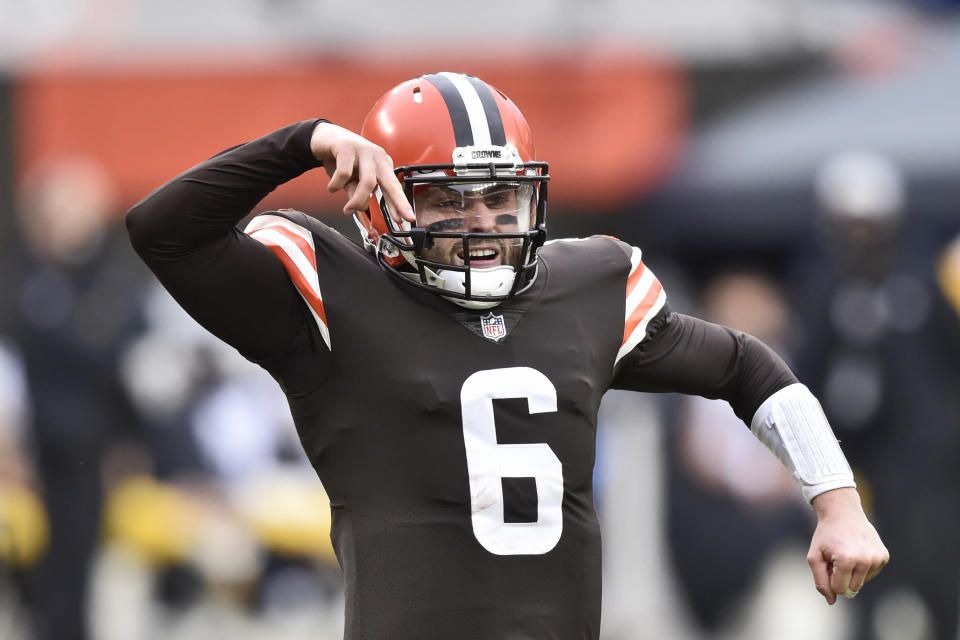 Cleveland Browns quarterback Baker Mayfield celebrates a 2-yard touchdown pass to tight end Austin Hooper during the second half of an NFL football against the Pittsburgh Steelers, Sunday, Jan. 3, 2021, in Cleveland. (AP Photo/David Richard)