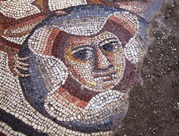 A section of the mosaic showing a theater mask uncovered in summer 2015 at an archeological dig in the town of Huqoq in northern Israel