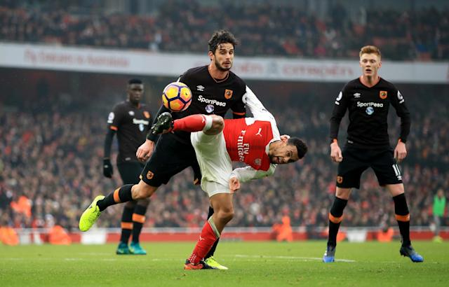 <p>Arsenal's Francis Coquelin (right) and Hull City's Andrea Ranocchia battle for the ball </p>