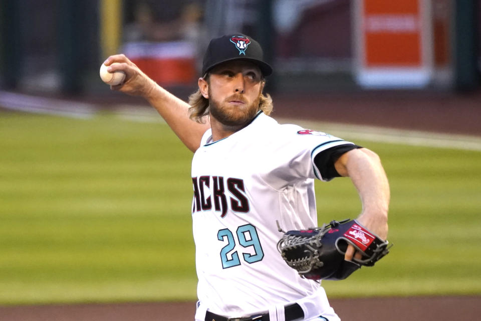 Arizona Diamondbacks pitcher Merrill Kelly throws in the first inning during a baseball game against the San Diego Padres, Friday, Aug 14, 2020, in Phoenix. (AP Photo/Rick Scuteri)