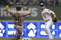 Milwaukee Brewers' Orlando Arcia tags out Pittsburgh Pirates' Jose Osuna as he turns a double play during the fourth inning of a baseball game Friday, Sept. 20, 2019, in Milwaukee. (AP Photo/Aaron Gash)