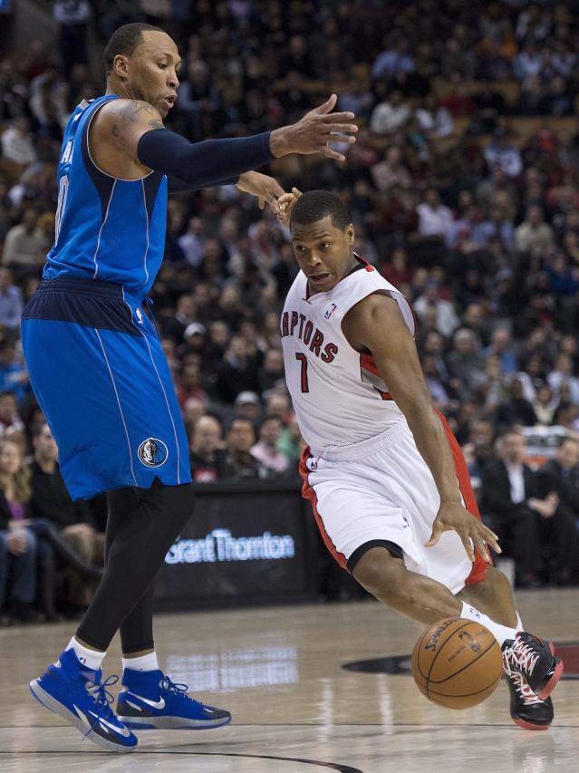 Toronto Raptors forward Kyle Lowry, right, drives past Dallas Mavericks forward Shawn Marion, left, during the first half of an NBA basketball game, Wednesday, Jan. 22, 2014 in Toronto. (AP Photo/The Canadian Press, Nathan Denette)