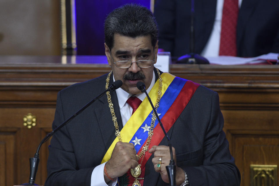 Venezuelan President Nicolas Maduro gives his annual address to the nation inside the chamber of the Constituent Assembly on the grounds of the National Assembly in Caracas, Venezuela, Tuesday, Jan. 14, 2020. (AP Photo/Matias Delacroix)