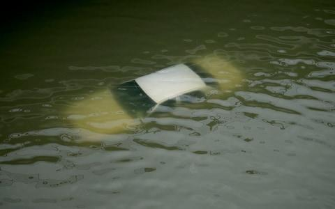 <span>A car is submerged on a freeway flooded by Tropical Storm Harvey </span> <span>Credit: AP </span>