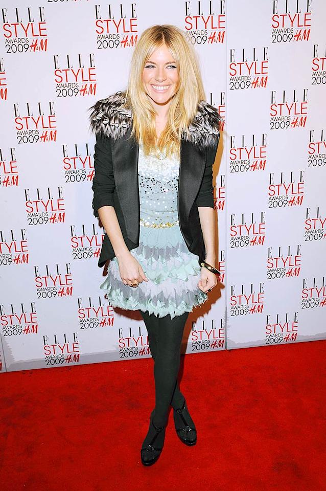 "Sienna Miller's Louis Vuitton black tuxedo jacket and tights failed to accentuate her adorable ruffled Matthew Williamson dress. Eamonn McCormack/<a href=""http://www.wireimage.com"" target=""new"">WireImage.com</a> - February 9, 2009"