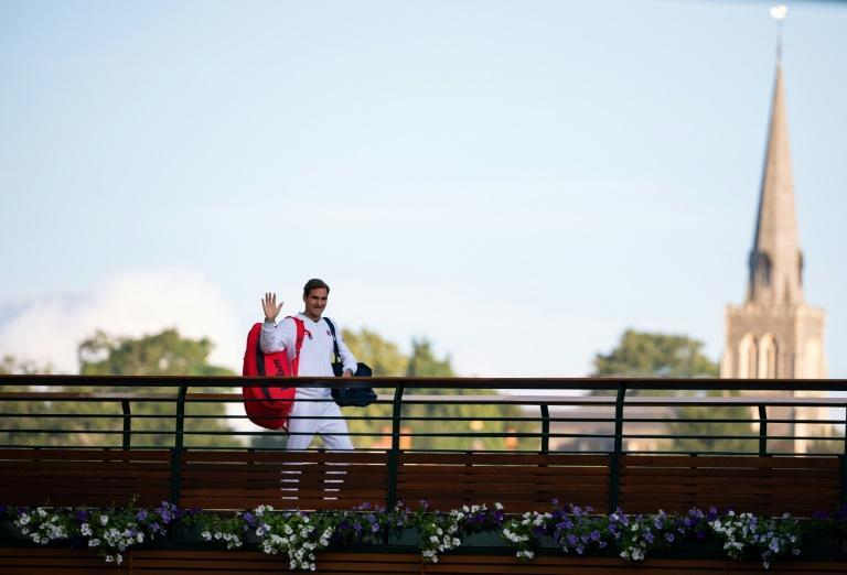 Bridge of sighs: Roger Federer waves to fans as he walks across the players bridge after losing his quarter-final to Hubert Hurkacz