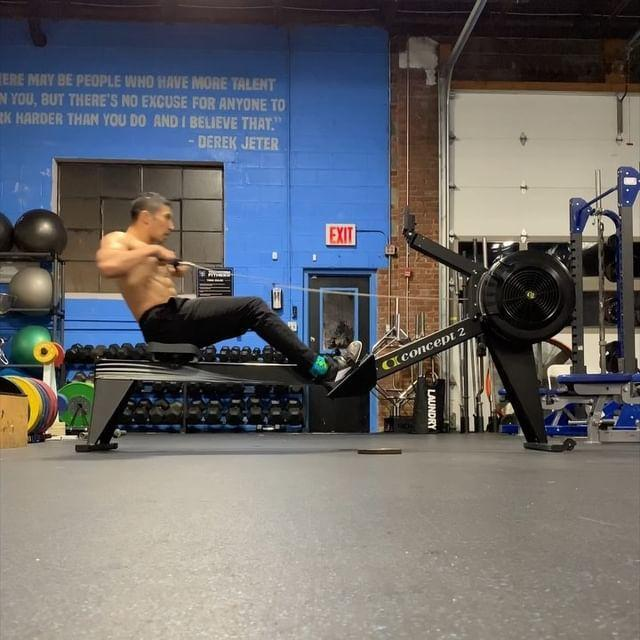 """<p>Set your rower for 2,000 meters, and set the timer. Begin rowing, using powerful strokes. This workout will encourage you to finish the workout that much faster; the sooner you wrap up, the fewer hollow rocks you have to do. Meanwhile, doing the hollow rocks will allow you to row with better aggression, creating larger and larger breathers between your rowing.</p><p>Additionally, the hollow rocks are a solid offset to the rowing work. Rowing teaches you to extend at the hip, while the hollow rocks force you to be in control of hip extension. The blend of moves creates a well-rounded overall workout. </p><p>- Set your rower for 2,000 meters and begin rowing.</p><p>- At the start of every minute (so when the rower hits 1 minute, then 2 minutes, then 3 minutes, and so on), get off the rower and do a weighted <a href=""""https://www.menshealth.com/fitness/a26887081/hollow-hold-form/"""" rel=""""nofollow noopener"""" target=""""_blank"""" data-ylk=""""slk:hollow rock"""" class=""""link rapid-noclick-resp"""">hollow rock</a> ladder. </p><p>- The first time you get off the rower, do 5 hollow rocks. The second time you get off, do 6; keep adding one hollow rock on every time you get off the rower. </p><p>- Aim to finish in 15 to 20 minutes. </p><p><a href=""""https://www.instagram.com/p/BvS3UyoheFA/?utm_source=ig_embed&utm_medium=loading"""" rel=""""nofollow noopener"""" target=""""_blank"""" data-ylk=""""slk:See the original post on Instagram"""" class=""""link rapid-noclick-resp"""">See the original post on Instagram</a></p>"""