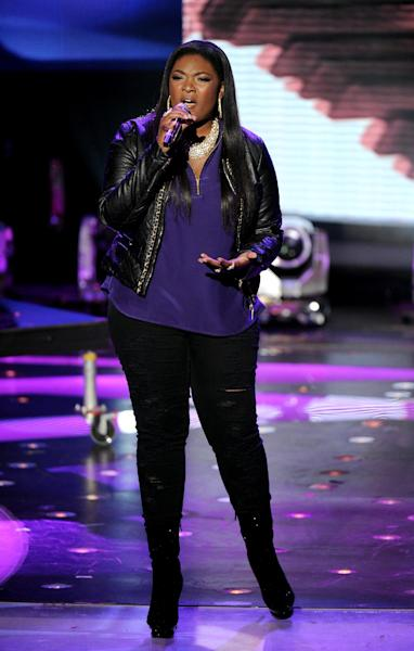 FILE - In this Wednesday, May 1, 2013 photo released by FOX, contestant Candice Glover performs onstage at FOX's American Idol Season 12 Top 4 To 3 Live Performance Show, in Hollywood, Calif. The current 12th season is set to conclude next Thursday, May 16, 2013, with a showdown between the 23-year-old R&B vocalist Glover of St. Helena Island, S.C., and 22-year-old country crooner Kree Harrison of Woodville, Texas. (AP Photo/FOX, Frank Micelotta)