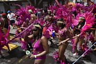 """<p><strong>When</strong>: Feb. 24-25</p> <p>Known as <a href=""""http://www.avirtualdominica.com/project/carnival-in-dominica/"""" class=""""link rapid-noclick-resp"""" rel=""""nofollow noopener"""" target=""""_blank"""" data-ylk=""""slk:&quot;Mas Domnik,&quot;"""">""""Mas Domnik,""""</a> the festivities happening within this commonwealth in the Caribbean are a feast of calypso music, carnival competitions, and activities all leading up to two days of what's known as street jump-up. About a month prior to these festivities, Carnival formally starts with an official opening parade and ceremony, with the noted - and final - dates being on the Monday and Tuesday before Ash Wednesday. Started by Catholic Europeans in the late 1700s - then with freed slaves getting engaged in celebrations through masquerades, dancing, and singing in the streets - present-day highlights include Afrikulture Stilt Walkers and parades such as a large street party known as J'ouvert.</p>"""