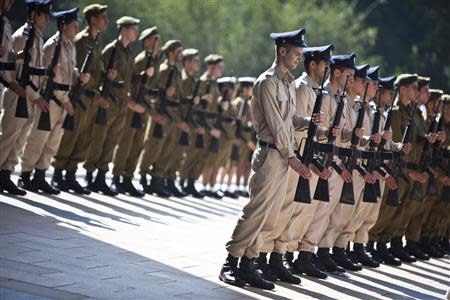 Israeli soldiers take part in an honour guard ceremony in Tel Aviv