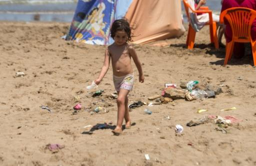 A child plays on a beach in Morocco's capital Rabat on July 12, 2018