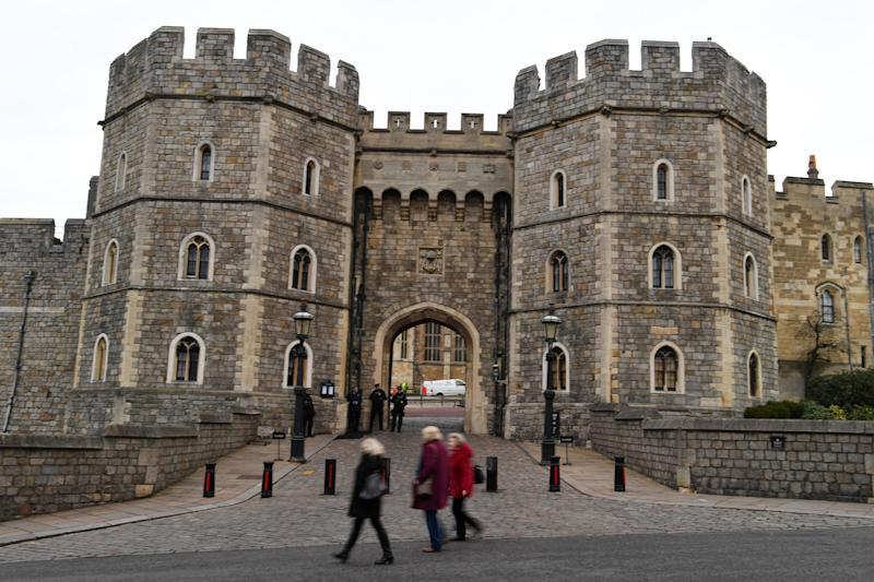 Tourists walk past Windsor Castle in Windsor, west of London on January 9, 2020. - Britain's Prince Harry and his wife Meghan stunned the British monarchy on Wednesday by quitting as front-line members -- reportedly without first consulting Queen Elizabeth II. In a shock announcement, the couple said they would spend time in North America and rip up long-established relations with the press. Media reports said the Duke and Duchess of Sussex made their bombshell statement without notifying either Harry's grandmother the monarch, or his father Prince Charles. (Photo by DANIEL LEAL-OLIVAS / AFP) (Photo by DANIEL LEAL-OLIVAS/AFP via Getty Images)