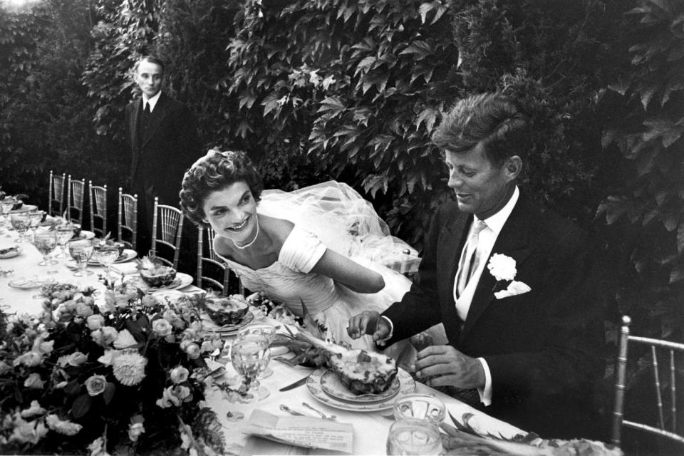 <p>Lisa Larsen took this photo of Jacqueline Kennedy and John F. Kennedy Jr. at their wedding in Newport, Rhode Island, in September 1953. </p>