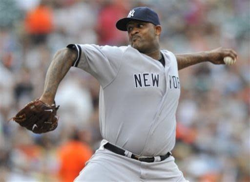 New York Yankees starting pitcher CC Sabathia delivers against the Baltimore Orioles in the first inning of a baseball game, Friday, June 28, 2013, in Baltimore. (AP Photo/Gail Burton)