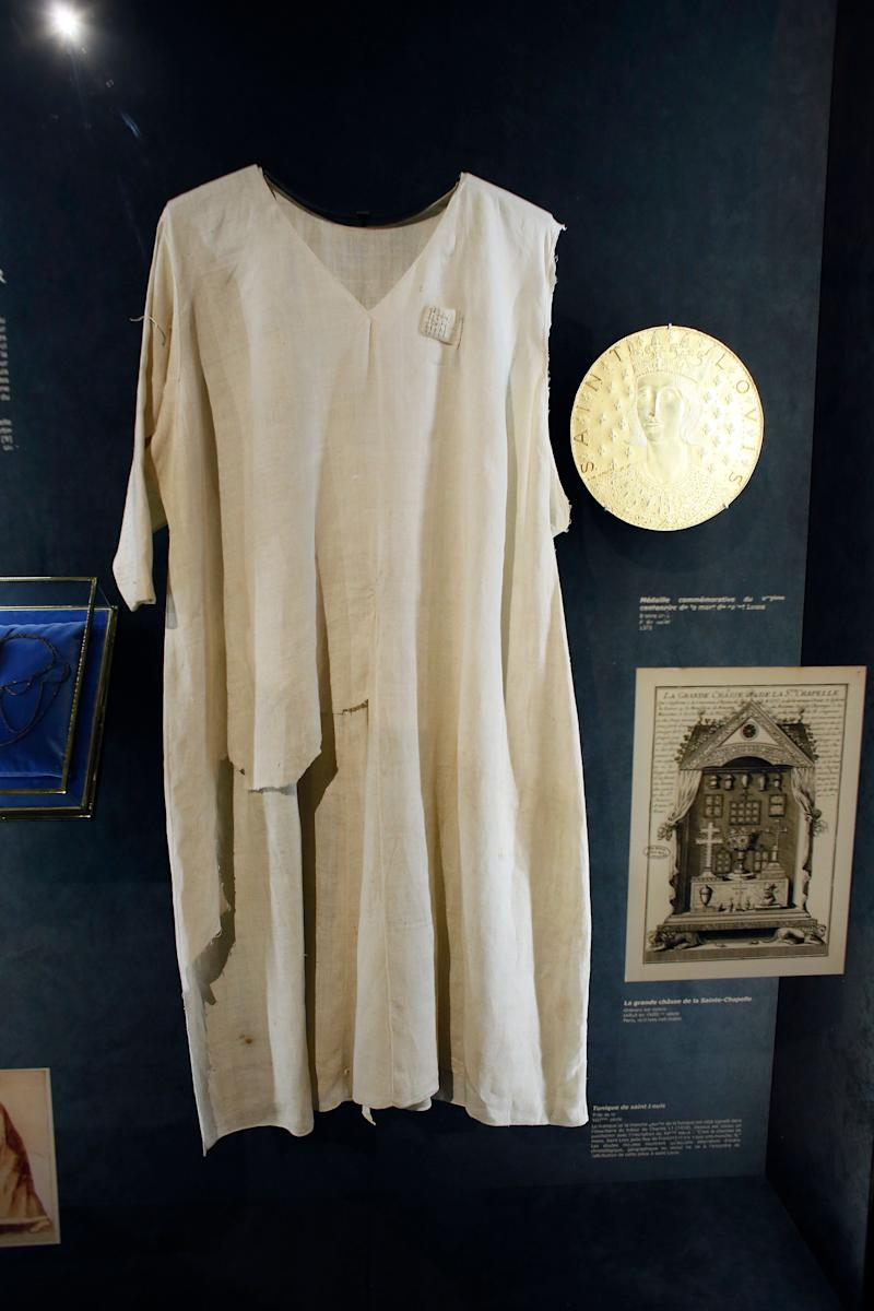 A view of the tunic allegedly worn by Saint Louis on display inside the Notre Dame cathedral in Paris (Picture: AFP/Getty)