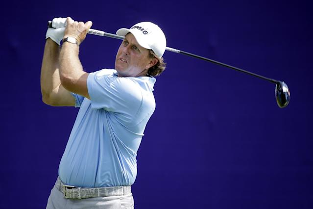 Phil Mickelson tees off on the first hole during the first round of the St. Jude Classic golf tournament Thursday, June 5, 2014, in Memphis, Tenn. (AP Photo/Mark Humphrey)