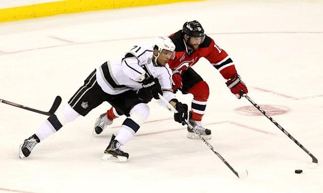 NEWARK, NJ - JUNE 02: Jordan Nolan #71 of the Los Angeles Kings and Stephen Gionta #11 of the New Jersey Devils go for a loose puck during Game Two of the 2012 NHL Stanley Cup Final at the Prudential Center on June 2, 2012 in Newark, New Jersey. (Photo by Jim McIsaac/Getty Images)