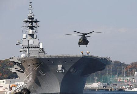 FILE PHOTO: A helicopter lands on the Izumo, Japan Maritime Self Defense Force's (JMSDF) helicopter carrier, at JMSDF Yokosuka base in Yokosuka