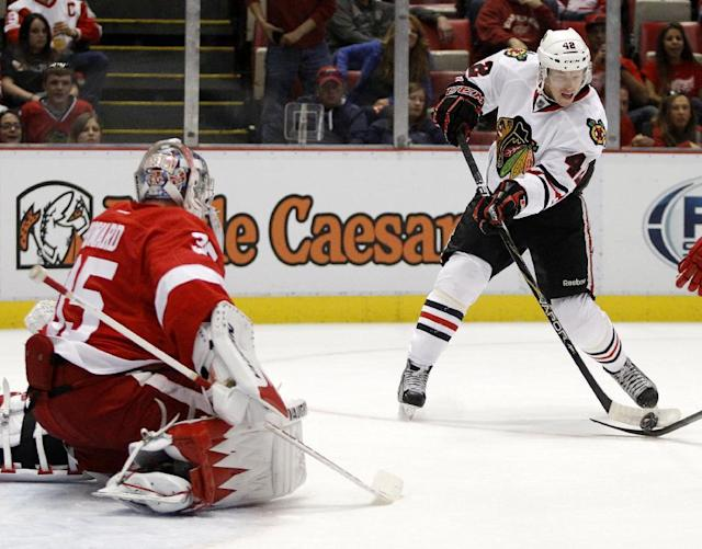 Chicago Blackhawks' Joakim Nordstrom (42), of Sweden, shoots his first period goal against Detroit Red Wings goalie Jimmy Howard (35) during a preseason NHL hockey game Sunday, Sept. 22, 2013 in Detroit. (AP Photo/Duane Burleson)