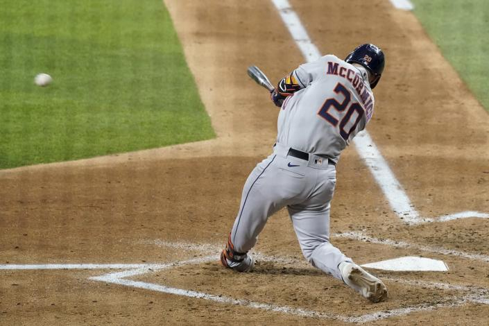 Houston Astros' Chas McCormick (20) follows through on a two-run single in the fourth inning of a baseball game against the Texas Rangers in Arlington, Texas, Wednesday, Sept. 15, 2021. The hit scored Kyle Tucker and Yuli Gurriel. (AP Photo/Tony Gutierrez)