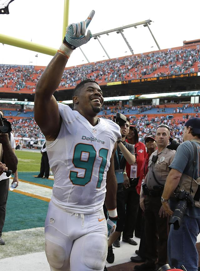 Miami Dolphins defensive end Cameron Wake (91) walks off the field after the Dolphins defeated the New England Patriots 24-20 in an NFL football game on Sunday, Dec. 15, 2013, in Miami Gardens, Fla. (AP Photo/Lynne Sladky)