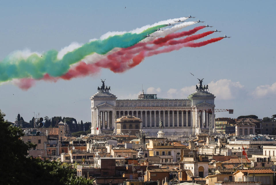 The Frecce Tricolori (Tricolor Arrows) aerobatic squad of the Italian Air Force fly over Rome and the Unknown Soldier monument, visible in foreground, Tuesday, June 2, 2020, as part of the celebrations for the 74th anniversary of the Italian Republic born on June 2, 1946. (AP Photo/Alessandra Tarantino)