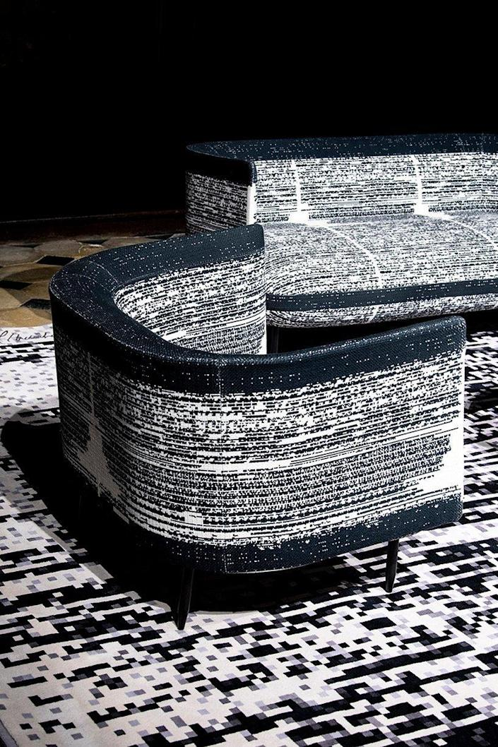 Seemingly pixelated chairs and couches featured in Miguel Chevalier and A+A Cooren Studio's collaborative