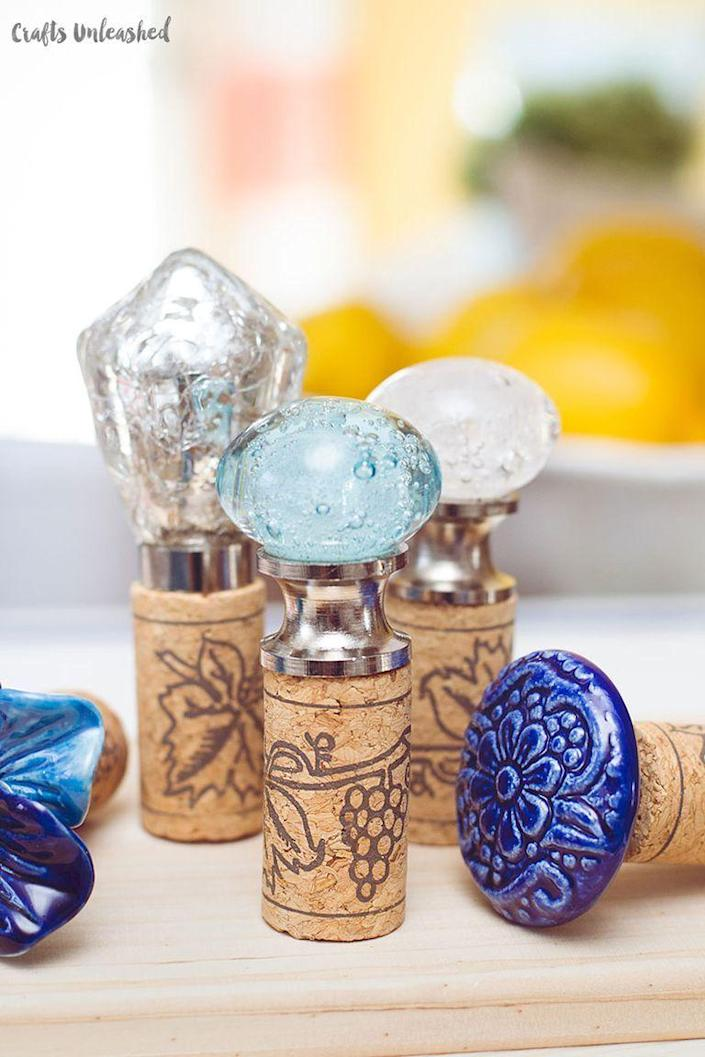 """<p>These DIY wine cork stoppers are such a fun way to liven up a bottle of wine. Plus, we'll take any excuse to pour ourselves a glass.</p><p><strong>Get the tutorial at <a href=""""http://blog.consumercrafts.com/craft-basics-main/diy-wine-cork-stoppers/"""" rel=""""nofollow noopener"""" target=""""_blank"""" data-ylk=""""slk:Crafts Unleashed"""" class=""""link rapid-noclick-resp"""">Crafts Unleashed</a>.</strong></p><p><strong><a class=""""link rapid-noclick-resp"""" href=""""https://go.redirectingat.com?id=74968X1596630&url=https%3A%2F%2Fwww.walmart.com%2Fip%2FBulk-Wine-Corks-1-x-15-16-Fit-Most-Bottles-100-Pack-Straight-Un-Recycled%2F132458600&sref=https%3A%2F%2Fwww.thepioneerwoman.com%2Fholidays-celebrations%2Fgifts%2Fg32307619%2Fdiy-gifts-for-mom%2F"""" rel=""""nofollow noopener"""" target=""""_blank"""" data-ylk=""""slk:SHOP CORKS"""">SHOP CORKS</a></strong> </p>"""