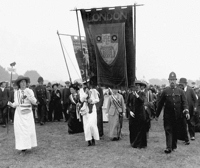 London contingent arriving at an event, with Mrs. Millicent Fawcett on the left of the banner. (PA)