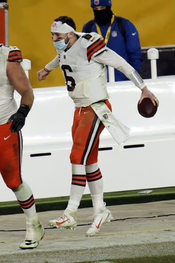 Cleveland Browns quarterback Baker Mayfield (6) celebrates after defeating the Pittsburgh Steelers in an NFL wild-card playoff football game, late Sunday, Jan. 10, 2021, in Pittsburgh. (AP Photo/Keith Srakocic)