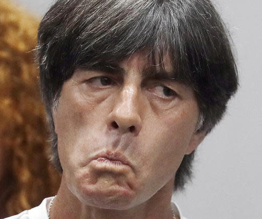 Germany head coach Joachim Loew waits for the beginning of a press conference on the eve of their Group F match against Sweden, during the 2018 soccer World Cup in Sochi, Russia, Friday, June 22, 2018. (AP Photo/Michael Probst)