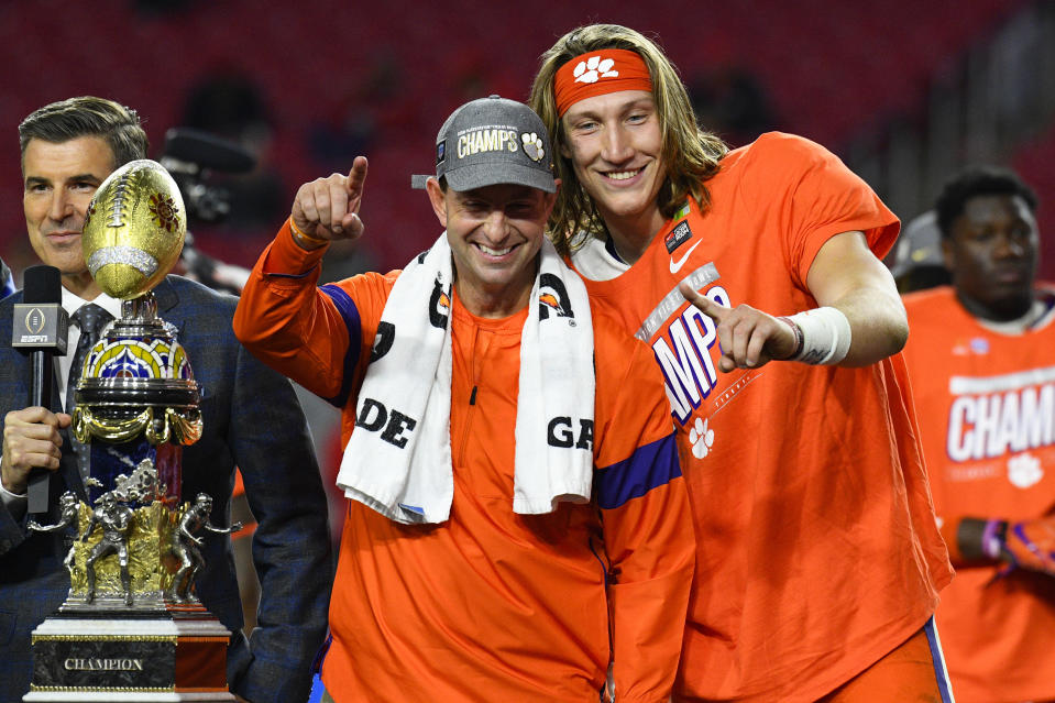 GLENDALE, AZ - DECEMBER 28: Clemson Tigers head coach Dabo Swinney and Clemson Tigers quarterback Trevor Lawrence (16) pose for a picture with the trophy after the 2019 PlayStation Fiesta Bowl college football playoff semifinal game between the Ohio State Buckeyes and the Clemson Tigers on December 28, 2019 at State Farm Stadium in Glendale, AZ. (Photo by Brian Rothmuller/Icon Sportswire via Getty Images)