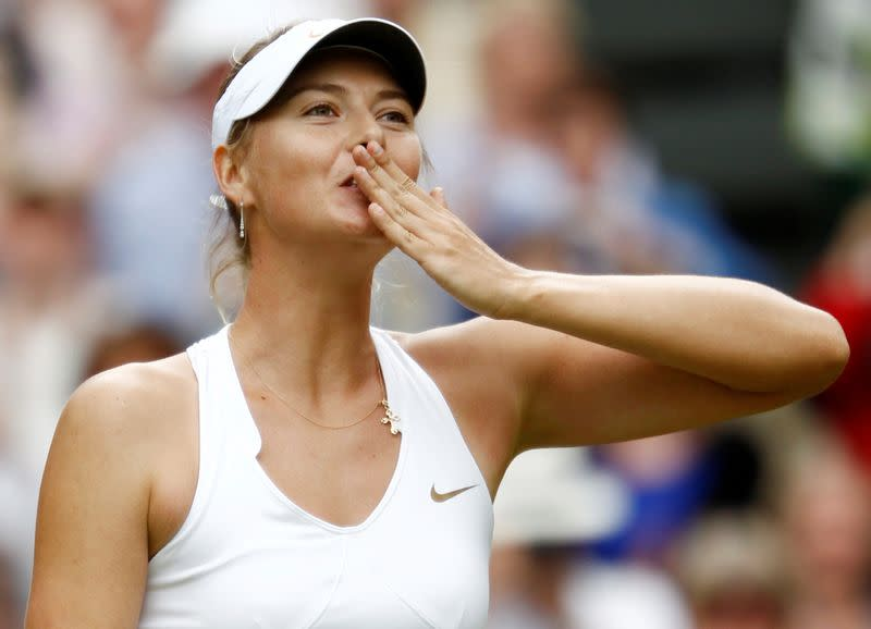 FILE PHOTO: Maria Sharapova of Russia celebrates after defeating Sabine Lisicki of Germany in their semi-final match at the Wimbledon tennis championships in London