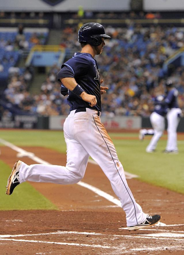 Tampa Bay Rays Ben Zobrist scores off of Evan Longoria's sacrifice fly during the first inning of a baseball game against the Kansas City Royals Saturday, June 15, 2013, in St. Petersburg, Fla. (AP Photo/Brian Blanco)