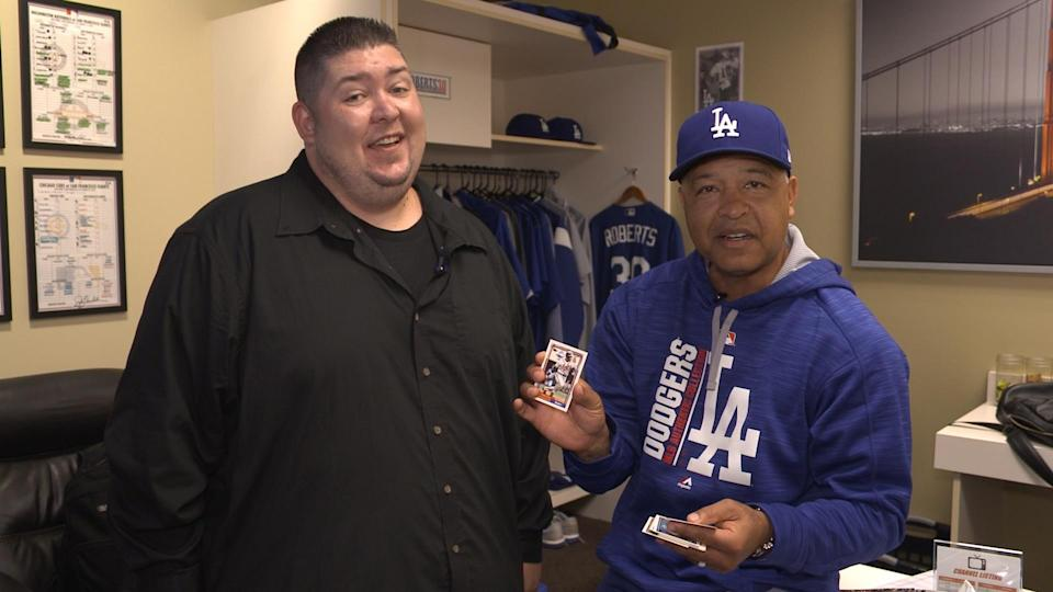 Dodgers manager Dave Roberts opens 1992 baseball cards. (Yahoo Sports)