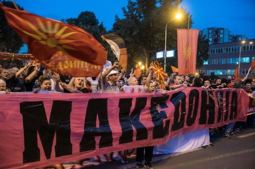 Protestors wave flags outside parliament in Skopje on June 13 against the proposed new name for the country. Greece's main opposition party is also opposed to the 'North Macedonia' name deal to end a nearly three-decade row between the neighbours