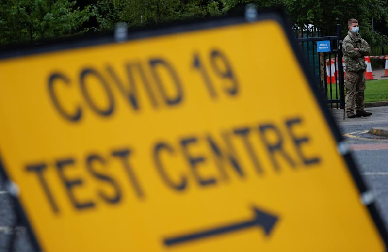 A soldier wearing a protective face mask stands near a sign at the entrance of a testing centre, as Blackburn with Darwen Council imposes local restrictions in an effort to avoid a local lockdown being forced upon the area, amid the coronavirus disease (COVID-19) outbreak, in Blackburn, Britain, July 15, 2020. REUTERS/Phil Noble
