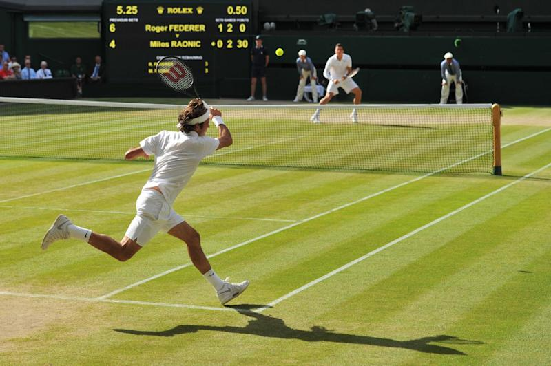 Switzerland's Roger Federer returns to Canada's Milos Raonic during their men's singles semi-final match on day 11 of the 2014 Wimbledon Championships at The All England Tennis Club in Wimbledon, southwest London, on July 4, 2014