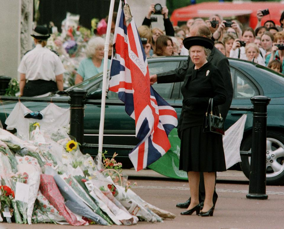 Queen Elizabeth II  and Duke of Edinburgh look at the mass of floral tributes laid outside Buckingham Palace in memory of  Diana, Princess of Wales, September 5.  [The Princess will be buried on the family estate of Althrop House after a ceremony at Westminster Abbey tomorrow].