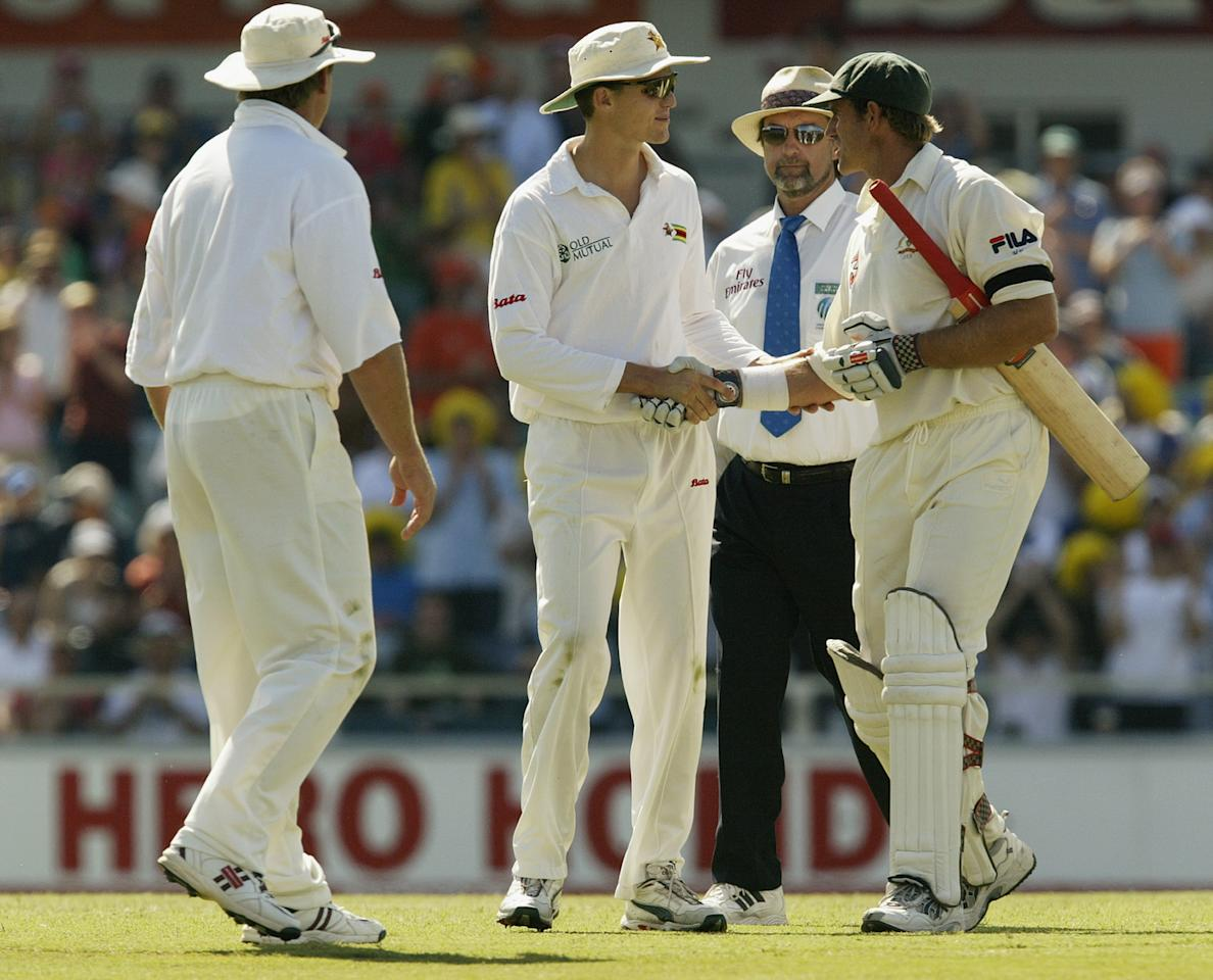 PERTH, AUSTRALIA - OCTOBER 10:  Matthew Hayden of Australia is congratulated by Zimbvawe players after breaking Brian Lara of The West Indies world record of 375 during day two of the First Test between Australia and Zimbabwe played at the WACA Ground on October 10, 2003 in Perth, Australia. (Photo by Hamish Blair/Getty Images)